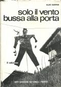 SOLO IL VENTO BUSSA ALLA PORTA. Fotografie di Flavio FAGANELLO. [ Esemplare con Dedica autografa dell'Autore.  Seconda Edizione. Trento, Arti Grafiche Saturnia, settembre  1971 ].